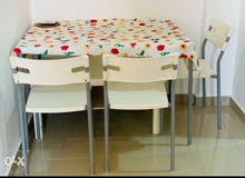 Ikea Dining table for sale with 4 chair excellent condition.Galss top.