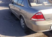 Beige Nissan Sunny 2011 for sale