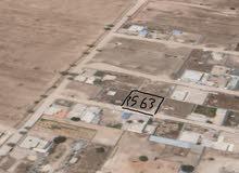 ارض مساحتها 563 متر  طمينة الارض ملك الموقع موضح بالصور