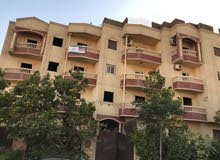 شقةروف300م مباني+150م روف فاضي بالحي10أمام قسم زايد4 متشطبه بأسانسير