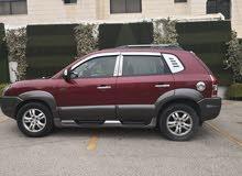 سيارة هونداي توسان استعمال سيدة لون خمري للبيع