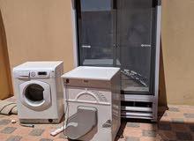 غسالتين وثلاجة يحتاجن تصليح