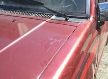 Maroon Mitsubishi Pickup 1988 for sale