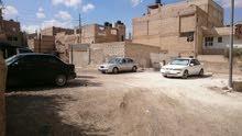 ارض للبيع في الرزقاء حي الحسين