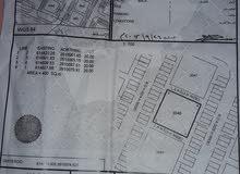 ارض للبيع سكنية تجارية عند شارع قار مساحتها 400م