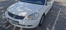 للبيع في ابوظبي سيارة ميتسوبيشي لانسر بومة  موديل 2013آخر اصدار (GLX) خليجي