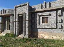 قطعة ارض 500متر بها منزل وملحق في طرابلس طريق المطار