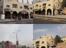 الزرقاء شارع الزهور مابين جسر الزواهره ودوار حي معصوم على الشارع الرأيسي