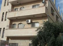 عمارة مكونة من 3 طوابق و خمسة شقق مؤجرة  للبيع الزرقاء حي الحسين