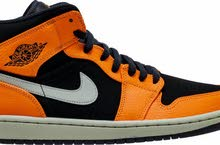 Air Jordan 1 Mid In Orange And Black.