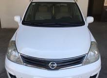 Nissan Tiida model 2011  1.8 mid option