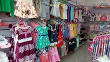 محل بيع ملابس اطفال