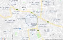 شارع الحصن مقابل البنك الأردني الكويتي