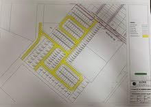 تملك ارض سكنية بشوارع اسفلت تملك حر لجميع الجنسيات بعرض اقساط علي (15) شهر من المطور