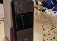 Huawei nova 7 i et airpods