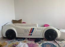 سرير شكل سيارة