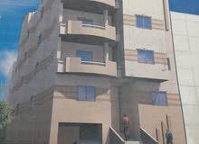 عماره للبيع بالحي الخامس 6اكتوبر منطقه الفلل علي شارع 30متر تاني نمره من المحور