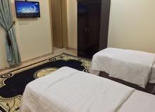غرف وشقق مفروشة بومي بالعزيزية