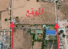 أرض بمساحة ثلاثة و نص هكتار مطلّة علي شارعين بوادي الربيع بالقرب من الرئسي