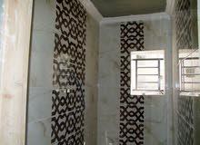 شقة طابق ارضي +تراس 70 م للبيع في ضاحة الحاج حسن