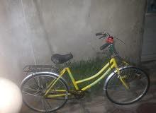 لبيع او مراوس بايسكل سياحي لون اصفر