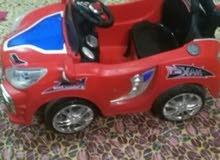 سياره شحن مال اطفال تحتوي على ريمونت للتحكم بالاضافه الىMP3 تحمل طفلين زغار