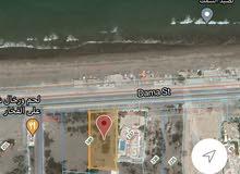 ارض سكنية في الحيل الشمالية اول خط البحر للبيع