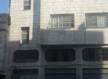 عماره للبيع مخازن + شقق