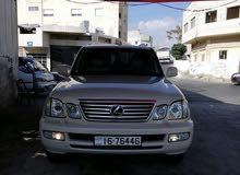 سيارات للبيع لكزس Lx470+أودي A4