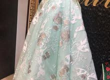 فستان فخم جدا سماوي و اوف وايت
