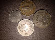 عملات معدنية قديمة من مختلف الجنسيات