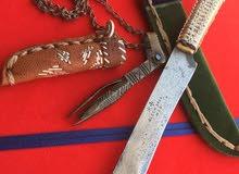 سكين قديمة مع منقاش قديم