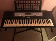Yamaha keyboard (PSR-E213) with stand