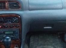 كيا كلاروس موديل السيارة 2000