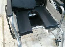 كرسي متحرك مع مقعدة حمام اخر قطعة عرض !!