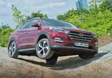 Maroon Hyundai Tucson 2017 for rent