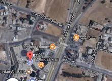 ارض مساحة دونم و 24 متر للبيع بعبدون بجانب السفارة الامريكية على شارعين