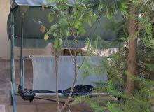 شقة ارضية مفروشة مميزة للبيع في دير غبار 245م مع حديقة وترسات 100م