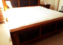 Beautifully hand carved Shisham wood bed with side tables