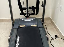 Treadmill with belt massager