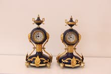 TWO CLOCKS - LUXURY AND OLD ONE