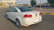 Expat Lady driven White EOS model 2014