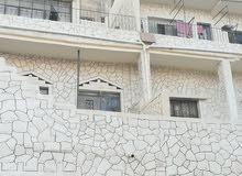 عماره للبيع طابقين في حي نزال الأخضر