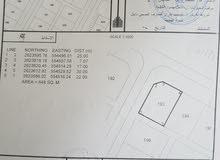 ارض سكنية. في مخطط الملدة شمال القاعدة الخط الاول خط السكني تجاري مقابل مصنع غاز