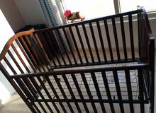 Baby crib with single hand drop rail (Bought from Babyshop)