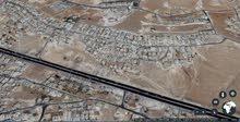 قطعة أرض تجارية مميزة للبيع على طريق الحزام (1001)