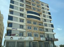 shop and flat in alkoud  محلات وشقق تجارية الخوض