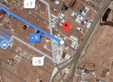 للبيع ارض 10 دونم صناعي في رجم الشامي شارع الميه