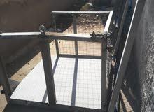 مصعد حديد داخلي واحد طن + رفوف حديد+ واجهه محل المنيوم3متر ب2ونص