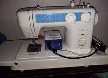 مكينة خياطة جانومي حديثة تعمل بالزر وبالدعسة